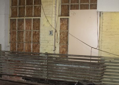 Ugly wall now hidden away in the guy's dressing room