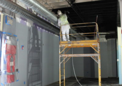 Painting the ceiling in the studio